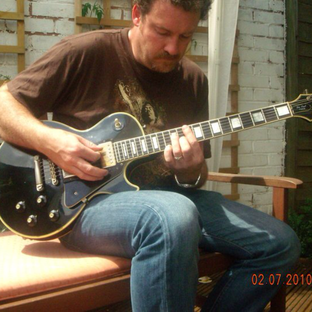 Playing Les Paul Custom